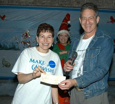 "Rick giving ""Make A Wish"" a check for the holidays"