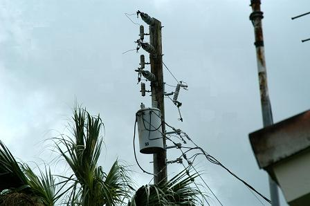 An electric pole with most of it's wires ripped away by Hurricane Frances.
